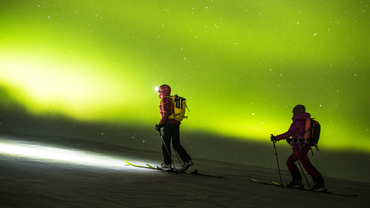 McKenna Peterson and Sam Cohen with the Northern Lights