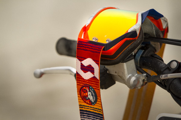 close up of the mojave prospect goggle hanging on a motorcyle handlebar